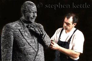 Stephen Kettle working on a statue of American philanthropist Sidney E Frank who funded the R J Mitchel work